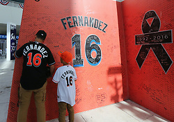 April 10, 2017 - Miami, FL, USA - Dominic Estevez, left, and his brother Armani Estevez look at the Jose Fernandez tribute before the start Miami Marlins' home opener, against the Atlanta Braves, at Marlins Park in Miami on Tuesday, April 11, 2017. (Credit Image: © David Santiago/TNS via ZUMA Wire)