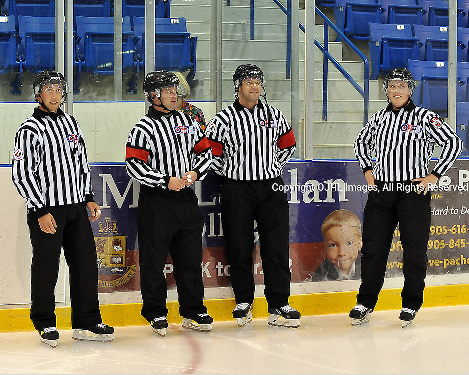 OAKVILLE, ON - Sep 6 : Ontario Junior Hockey League game between Milton Icehawks and Oakville Blades. Opening night of the 2013/2014 season. OHA Officials during the player introductions. Referees Scott Brown and Darryl Wolfe along with Linesmen Kyle Melko and Scott Gallant.<br /> (Photo by Shawn Muir / OJHL Images)