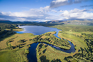 The river Spey meanders its way into Loch Insh in the Cairngorms National Park, Scotland.