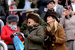 Female racegoers react during Ladies Day of the 2018 Cheltenham Festival at Cheltenham Racecourse.