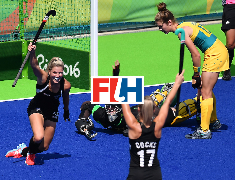 New Zealand's Gemma Flynn (L) celebrates after scoring her team's third goal during the the women's quarterfinal field hockey New Zealand vs Australia match of the Rio 2016 Olympics Games at the Olympic Hockey Centre in Rio de Janeiro on August 15, 2016. / AFP / MANAN VATSYAYANA        (Photo credit should read MANAN VATSYAYANA/AFP/Getty Images)