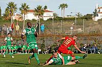 *Illiass Bel Hassani* of AZ Alkmaar scores the third goal to make it 2-1, *Yrondu Musavu-King* of FC St Gallen, (l), Muheim Miro Max Maria of FC St Gallen (r)
