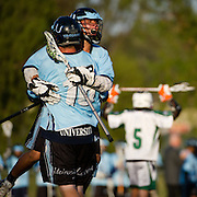 4/27/12 6:33:39 PM --- LACROSSE SPORTS SHOOTER ACADEMY 009 --- university High players celebrate winning their lacrosse match. Photo by Jane Gershovich, Sports Shooter Academy
