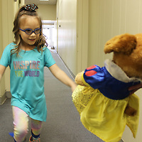 Amelia Moody, who underwent selective dorsal rhizotomy surgery last summer to cure leg spasms, freely walks towards her stuffed puppy, Snow White.