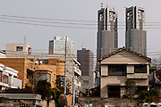 The Tokyo Metropolitan Government building towering over small houses in Shinjuku, Tokyo, Japan Sunday Sunday, January 20th 2008