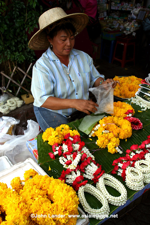 Thai garlands are called Phuang Malai.  Garlands are presented and worn at festive occasions, such as graduation, birthdays and weddings, or just for good luck.  Vendors selling a variety of flower garlands are to be found near temples, shrines, statues or even at street corners.
