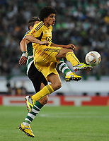 20120329: LISBON, PORTUGAL - Football - UEFA Europe League 2011/2012 - Quarter-finals, First leg: Sporting CP vs Metalist<br /> In picture: Sporting's Daniel Carrico, back, fights for the ball with Metalist's Taison, from Brasil.<br /> PHOTO: Alvaro Isidoro/CITYFILES