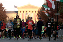 Runners at the start line of the 2016 Philadelphia Marathon, on Nov. 20, 2016, on the Benjamin Franklin Parkway, in Center City, Philadelphia, PA.  <br /> <br /> With the city of Philadelphia taking over organization the course, as well as start and finish locations are slightly different from past years. The winners for 2016 are, in the Mens race, Kimutai Cheruiyot in 2:15:53, and Taylor Ward in the Womens race in 2:36:25