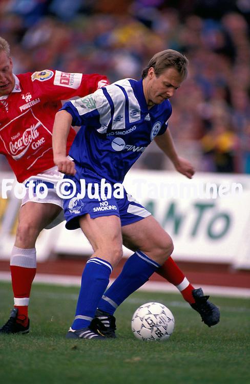 11.07.1993, Pori, Finland..Veikkausliiga  / Finnish League..FC Jazz Pori v FinnPa.Pasi Rasimus (FinnPa) v Rami Nieminen (Jazz).©Juha Tamminen