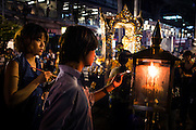 Shrine goes light insence at the peaceful Erawan Shrine in central Bangkok, August 14, 2015, days before the bombing. Which killed dozens and injured many more.