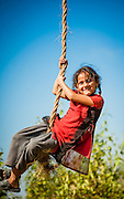 Girl having fun with swing (Nepal)