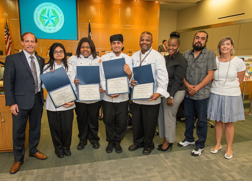 Houston ISD trustee Greg Meyers recognizes the Westside High School culinary team along with Chef Reginald Martin and Peggi Stewart during a Board of Trustees meeting, September 10, 2015.