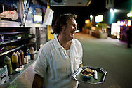 """David Long, known as Chef Dave, serves his own gourmet street food from his mobile restaurant parked outside Duke's Cardiff Office bar in Cardiff By The Sea, March 26, 2010. Long, a professional chef, owns and operates """"Dave de Jour,"""" which caters to the bar-hopping crowd in Leucadia, Encinitas and Cardiff By The Sea."""