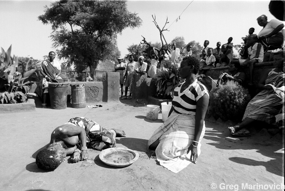 Sowetan Cookie Kashane at her initiation as Ndau medium / diviner at Dolly Village, Venda, South Africa Feb 4, 1991. (Greg Marinovich)