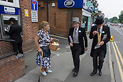 Top hatted and tailed gentlemen refuse to buy buttonhole flowers for their suits during the annual Royal Ascot horseracing festival in Berkshire, England. Royal Ascot is one of Europe's most famous race meetings, and dates back to 1711. Queen Elizabeth and various members of the British Royal Family attend. Held every June, it's one of the main dates on the English sporting calendar and summer social season. Over 300,000 people make the annual visit to Berkshire during Royal Ascot week, making this Europe's best-attended race meeting with over £3m prize money to be won.