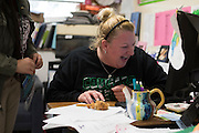 Coach Krystal Morrow works at her desk at Bryan Adams High School on March 24, 2016 in Dallas, Texas. (Cooper Neill for The Texas Tribune)