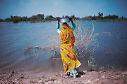 Flood affected people along the roads of Badin District, Sindh, Pakistan on September 17, 2011. In August 2011, Heavy monsoon rains triggered flooding in lower parts of Sindh and northern parts of Punjab. To date, the Government of Pakistan reports that more than 5.3 million people have been affected, Over 200 people have lost their lives, over 4.2 million acres of land flooded and 1.59 million acres of crops destroyed. UNHCR is supplying 10,000 tents, 20,000 plastic sheets and 10,000 kits of household items as an emergency response to flood affected communities in Sindh Province. Contingent on an emergency funding appeal, UNHCR will be able to supply another 20,000 tents and relief items.