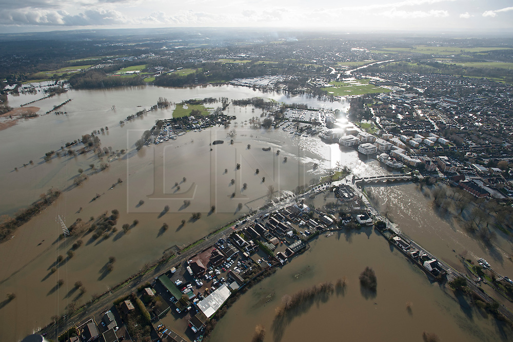 **Previously unseen pics from original aerial shoot** © London News Pictures. 09/02/2014. Chertsey, UK.  Aerial view showing flooding covering Chertsey, Surrey with Chertsey bridge on the right. The Thames river has hit record levels causing extensive flooding to parts of the southeast of England. Photo credit : Ben Cawthra/LNP