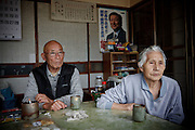 "iitate, May 31 2011 - .Take Takano, 79 , and his wife Sumiko, 82, watching the road 399 from their living room.."" We retired 2 year ago and we closed our grocer's shop. Before the evacuation, we had a school bus stoppng in front of the shop..We will live in a temporary appartment for 1 or 2 years..We never thought that we would have such a problem before we die..People in the village have always been against the plant, even when they built it. We didn't believe in the government when they said it was safe."""