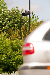 ANPR cameras monitoring traffic to identify unpaid vehicle tax