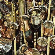 Brass ladles hang outside a metal goods shop in Istanbul's historic Grand Bazaar