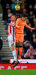 STOKE-ON-TRENT, ENGLAND - Wednesday, November 29, 2017: Liverpool's Roberto Firmino and Stoke City's captain Ryan Shawcross during the FA Premier League match between Stoke City and Liverpool at the Bet365 Stadium. (Pic by David Rawcliffe/Propaganda)