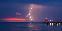 "Mere minutes after watching a partial solar eclipse set on Lake Michigan on May 20,2012,  This awesome lightning storm gave me several opportunities to catch lightning strikes over South Beach pier, in South Haven Michigan.  This image is natively a 10x20"" panoramic print and is recommended for metallic paper."
