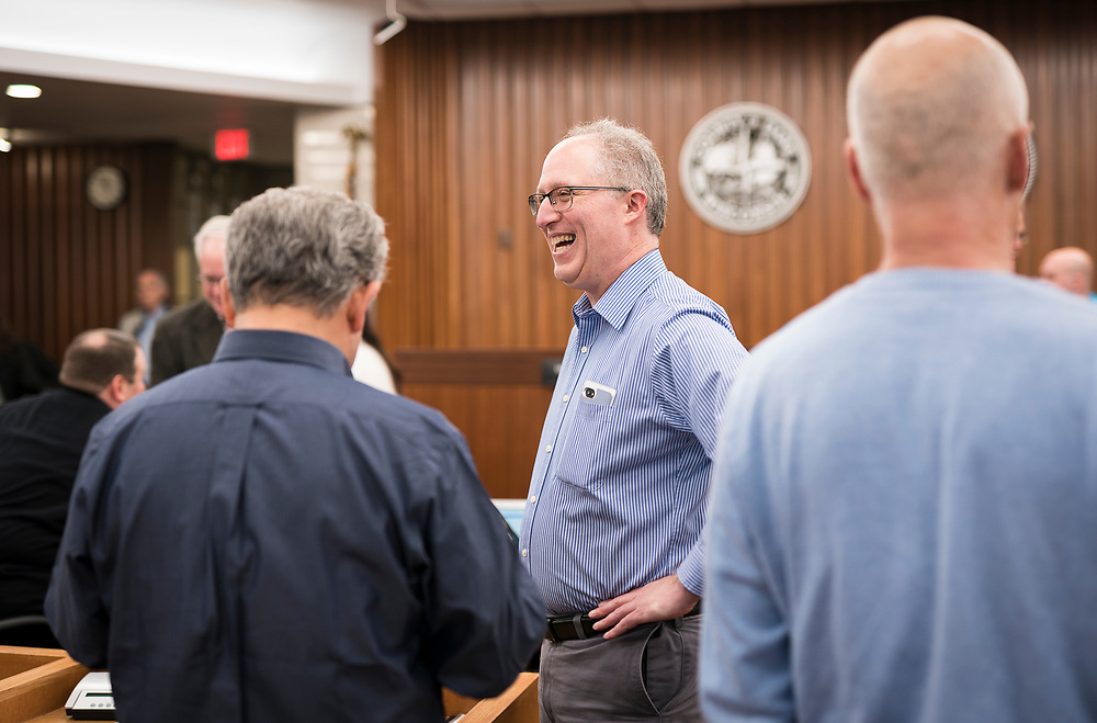 Mark Clear, Alder District 19, laughs before the during the swearing in ceremony for Satya Rhodes-Conway and newly elected Aldersat the City County Building in Madison, WI on Tuesday, April 16, 2019.