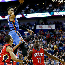 Dec 21, 2016; New Orleans, LA, USA;  Oklahoma City Thunder guard Russell Westbrook (0) shoots over New Orleans Pelicans guard Tim Frazier (2) and guard Jrue Holiday (11) during the second quarter of a game at the Smoothie King Center. Mandatory Credit: Derick E. Hingle-USA TODAY Sports
