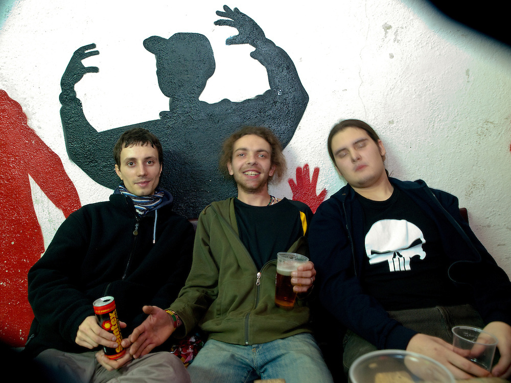 Three students  relaxing at the Bunkr Climbing & Music Club Parukarka in Prague 3 - Zizkov during an early morning after a long night.