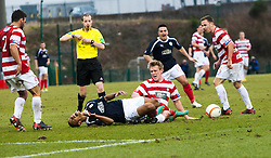 Hamilton's Jonathan Page gets a red card from Referee William Collum after this tackle on Falkirk's Lyle Taylor.<br /> Hamilton 1 v 2 Falkirk, Scottish Cup quarter-final, Saturday, 2nd March 2013.<br /> &copy;Michael Schofield.