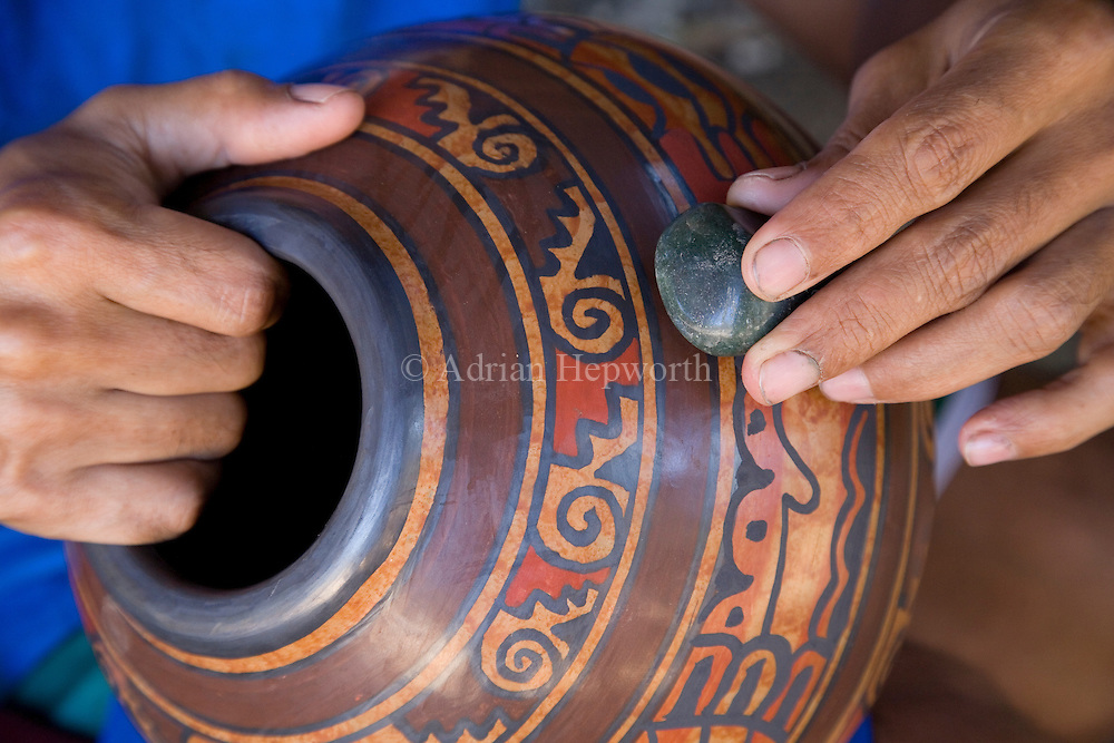 A potter polishing with a jade stone in the village of Guatil near Santa Cruz, Guanacaste, Costa Rica.<br /> <br /> For pricing click on ADD TO CART (above). We accept payments via PayPal.