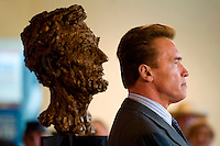 Gov. Schwarzenegger stands near the bust of President Abraham Lincoln, inside the California Museum, as part of a kickoff ceremony for the museum's hosting of the Lincoln Bicentennial Exhibit. The bust came from his office in the State Capitol.