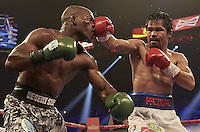 Boxing: WBO Welterweight Title: Manny Pacquiao (R) in action vs Timothy Bradley during fight at MGM Grand Garden Arena. <br /> Las Vegas, NV 4/12/2014<br /> CREDIT: Jed Jacobsohn (Photo by Jed Jacobsohn /Sports Illustrated/Getty Images)<br /> (Set Number: X158076 TK1 )