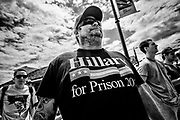 "The ""Hillary for Prison 2016"" T-shirt was very popular amongst Trump supporters. Thanks to clever marketing this slogan could be found on just about any type of merchandise at his events or online. Anaheim, Calif. May 26, 2016. (Photo by Gabriel Romero ©2016)"