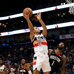 Mar 24, 2019; New Orleans, LA, USA; New Orleans Pelicans guard Frank Jackson (15) shoots over Houston Rockets guard Iman Shumpert (1) during the second half at the Smoothie King Center. Mandatory Credit: Derick E. Hingle-USA TODAY Sports