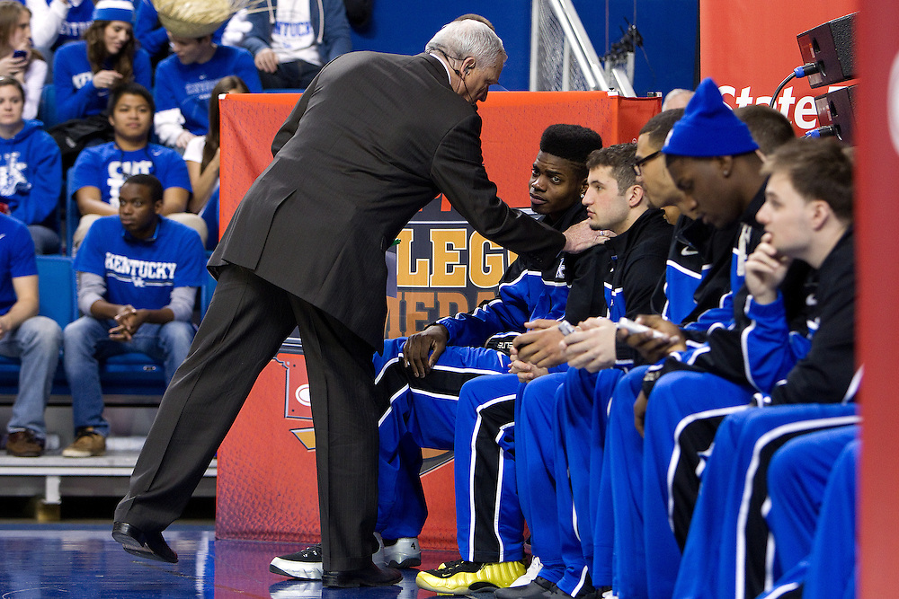 ESPN Gameday analyst Digger Phelps pats UK forward Nerlens Noel on the shoulder while greeting the players in between segments before the Missouri vs. Kentucky game, Saturday, Feb. 23, 2013 in Lexington.
