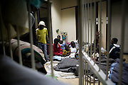 Families seek refuge in the stairwell at Harvest House in central Harare Zimbabwe. Up to 700 men, women and children were seeking refuge at the HQ of the rival political party, the MDC after fleeing rural and more recently urban areas around the capitol city Harare. ..Earlier in the day, the HQ received a tip of that a raid by ZanuPF/Police was imminent. Most fled the HQ in expectation of the raid which occurred at midday, resulting in the arrest of 60 persons and internment at local police station. ..With night time temperatures dropping to 5-6deg celsius many of the victims and IDP have little alternative but to return to the MDC HQ to seek shelter,warmth and food at night.