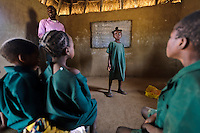 A young girl reciting a poem during a lesson about HIV, St Mary's, Monze, Zambia.