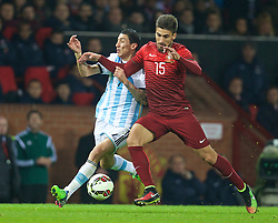 MANCHESTER, ENGLAND - Tuesday, November 18, 2014: Argentina's Angel Di Maria in action against Portugal's Andre Gomes during the International Friendly match at Old Trafford. (Pic by David Rawcliffe/Propaganda)