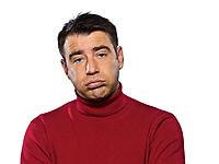 caucasian man pouting sulk sullen puckering fatigue tired studio portrait on isolated white backgound