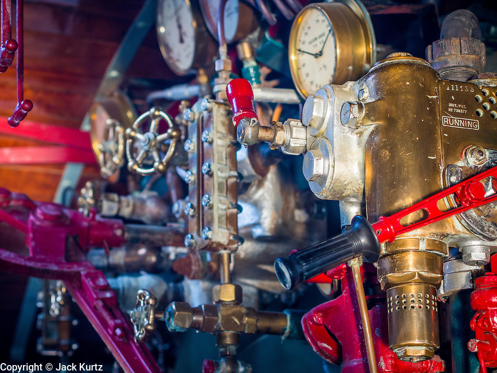 "05 DECEMBER 2013 - BANGKOK, THAILAND:  The controls of a steam engine train put into service for the 86th birthday of Bhumibol Adulyadej, the King of Thailand. Dec. 5, the King's Birthday, is a national holiday in Thailand, and is also celebrated as the country's ""Fathers' Day."" The State Railways of Thailand put on special trains to take people to the King's ""Summer Palace"" in the oceanside community of Hua Hin where the King granted a public audience. There were also merit making ceremonies throughout the country.  Many people wear yellow on the King's Birthday because yellow is the color associated with his reign. As of 2013, he was the longest reigning monarch in the world.          PHOTO BY JACK KURTZ"