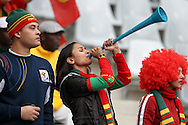 CAPE TOWN, SOUTH AFRICA, MONDAY 21 June 2010, fans of Portugal blow a vuvuzela during the match between Portugal and Korea PRK held at the new Cape Town Stadium in Green Point during the 2010 FIFA World Cup..Photo by Roger Sedres/Image SA