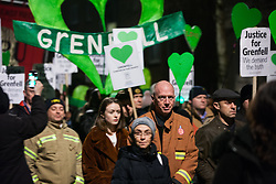 London, UK. 14th February, 2019. Matt Wrack, General Secretary of the Fire Brigades Union (FBU) joins members of the Grenfell community taking part in the Grenfell Silent Walk around North Kensington on the monthly anniversary of the fire on 14th June 2017. 72 people died in the Grenfell Tower fire and over 70 were injured.
