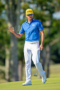 Benjamin Hebert (FRA) acknowledges the crowd as he makes par on the 9th green during the final round of the Aberdeen Standard Investments Scottish Open at The Renaissance Club, North Berwick, Scotland on 14 July 2019.