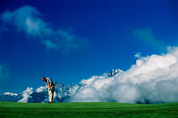 Jamie Spence of England putting for eagle on 7th green, a drivable par 4 hole, amongst the mountains and clouds.<br /> Canon European Masters 1998, Crans sur Sierre, Switzerland.<br /> (Photo by Nick Walker/Sport Picture Library)