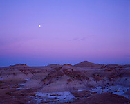 Gibbous Moon rising after sunset over landscape of Dinosaur Provincial Park, Alberta. Dark band near horizon is Earth's shadow. Pink band above it is Belt of Venus -- sunlight hitting upper atmosphere. <br /> <br /> Taken with Plaubel Makina 6x7 camera with 80mm lens and Fujichrome Velvia 50 slide film 120-format. Exposure metered.