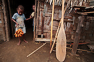 "Every morning the children of Lutes village wait at the baker's house for the local dohnuts, called ""Kado"". Uleveo, Maskelyne Island, Malampa Province, Malekula, Vanuatu"