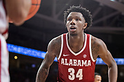 FAYETTEVILLE, AR - MARCH 9:  Tevin Mack #34 of the Alabama Crimson Tide plays defense on the inbound pass during a game against the Arkansas Razorbacks at Bud Walton Arena on March 9, 2019 in Fayetteville, Arkansas.  The Razorbacks defeated the Crimson Tide 82-70.  (Photo by Wesley Hitt/Getty Images) *** Local Caption *** Tevin Mack