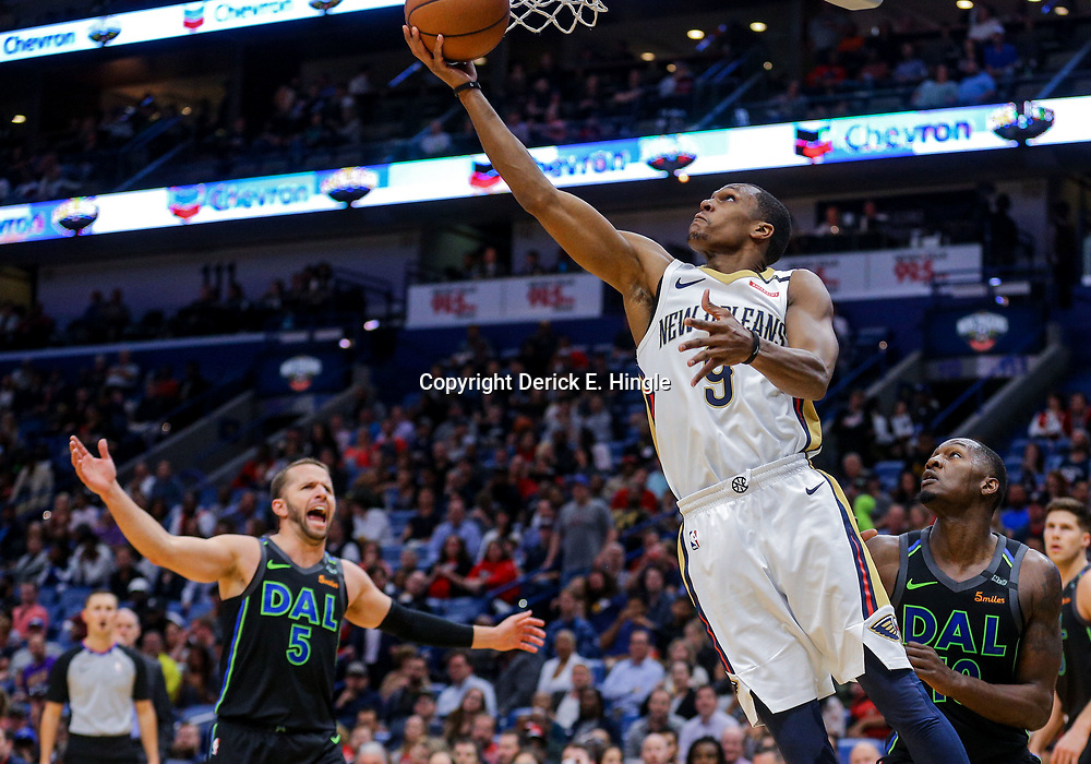 Mar 20, 2018; New Orleans, LA, USA; New Orleans Pelicans guard Rajon Rondo (9) shoots over Dallas Mavericks forward Dorian Finney-Smith (10) during the second half at the Smoothie King Center. Pelicans defeated the Mavericks 115-105. Mandatory Credit: Derick E. Hingle-USA TODAY Sports